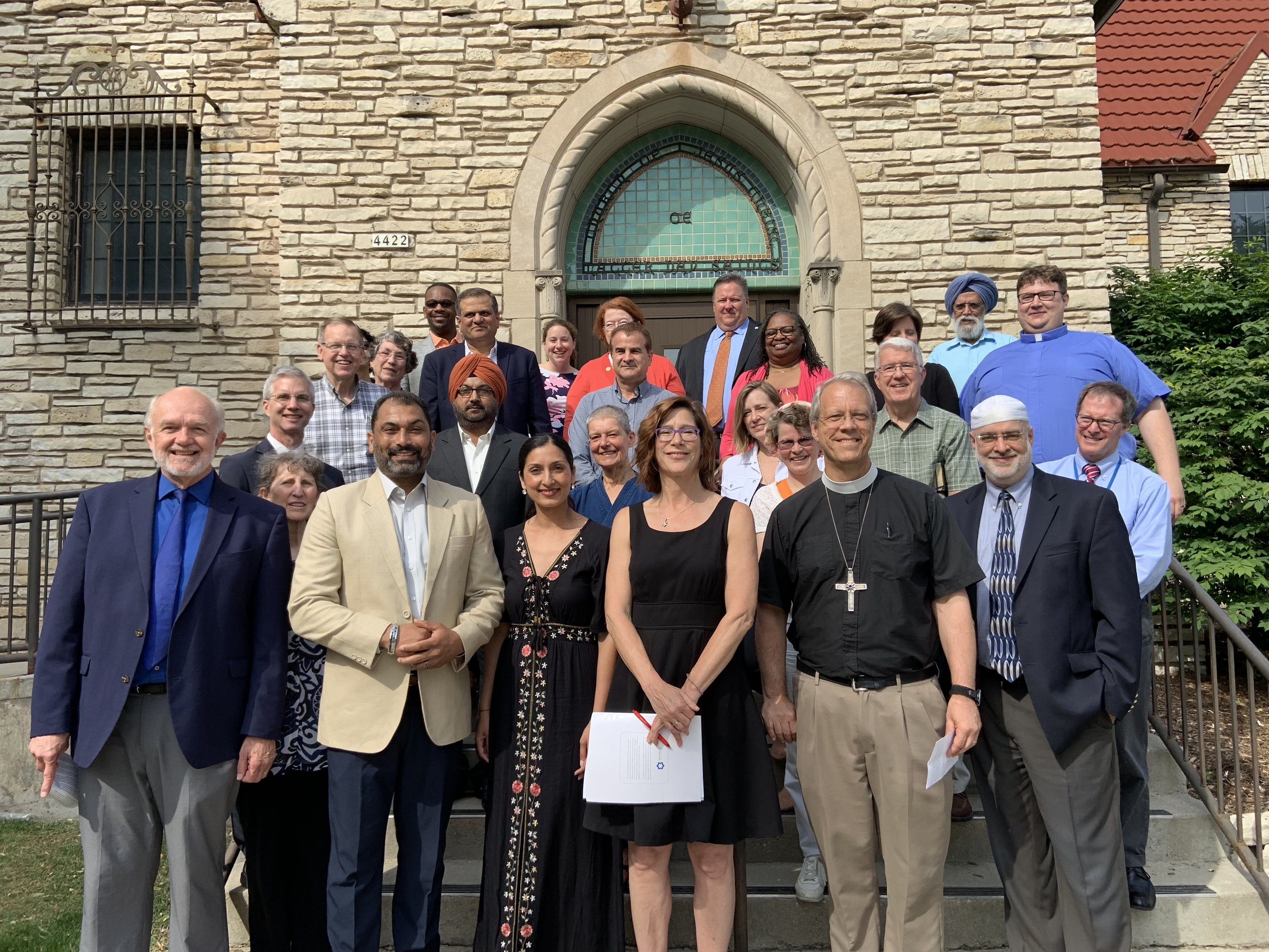 Members of the Interfaith Conference of Greater Milwaukee with Tom Heinen (first left) and Pardeep Kaleka (next to Tom)