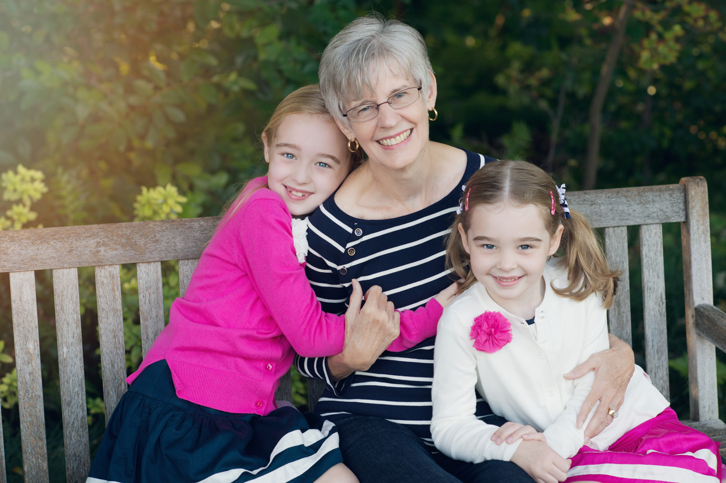 grandmother and granddaughters in the park