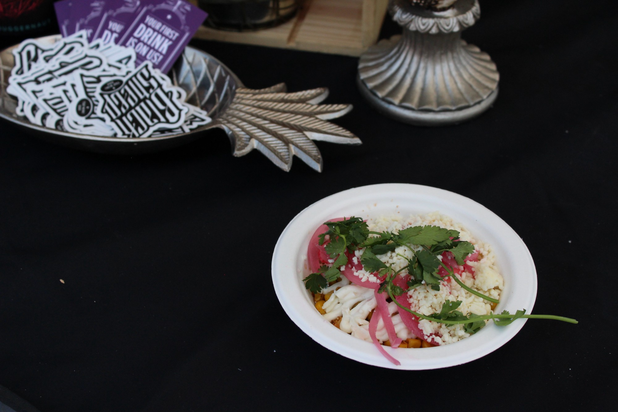Dish from Black Sheep MKE: Charred Corn with pickled onions, cotija cheese, picante sauce and a garlic crema.