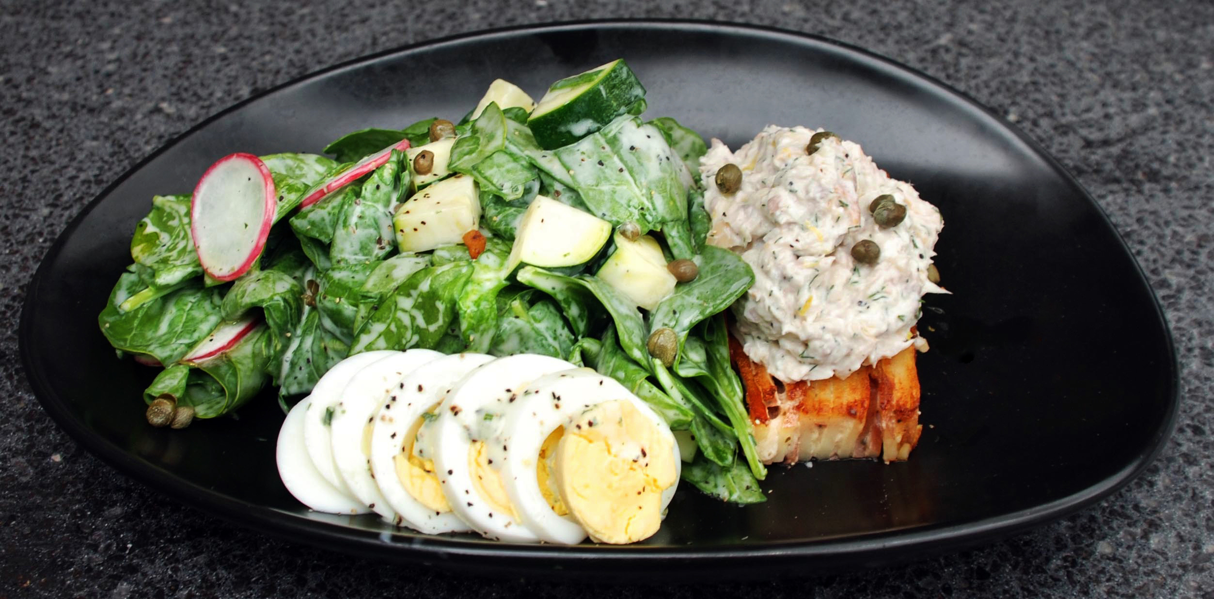 Smoked Trout Salad -spinach, creamy potato gratin, radish, zucchini, shaved egg, caper, herbed buttermilk vinaigrette