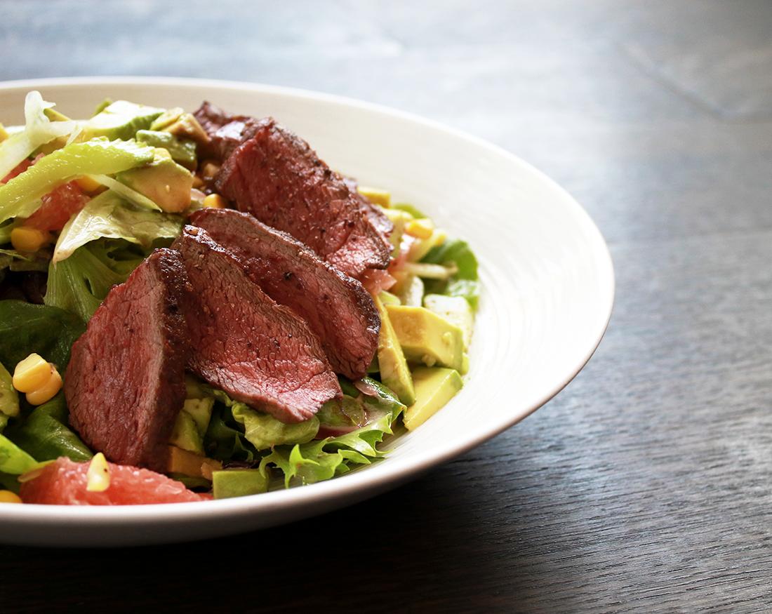 Steak Salad with deb & jim crum's lettuce, avocado, corn, grapefruit, celery, and champagne vinaigrette.