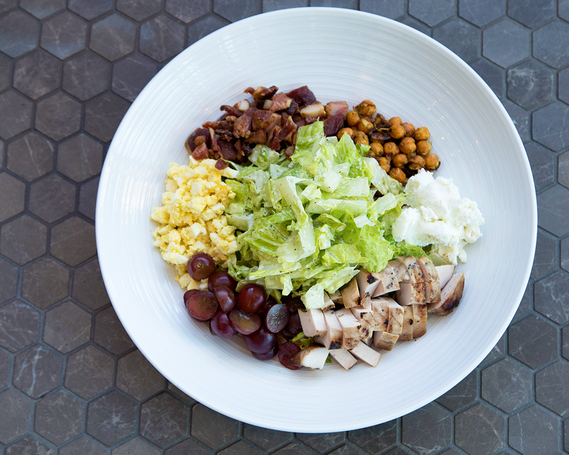 Cobb Salad with grilled chicken, chopped egg, bacon, moroccan toasted chickpeas, red grapes, and green goddess dressing.