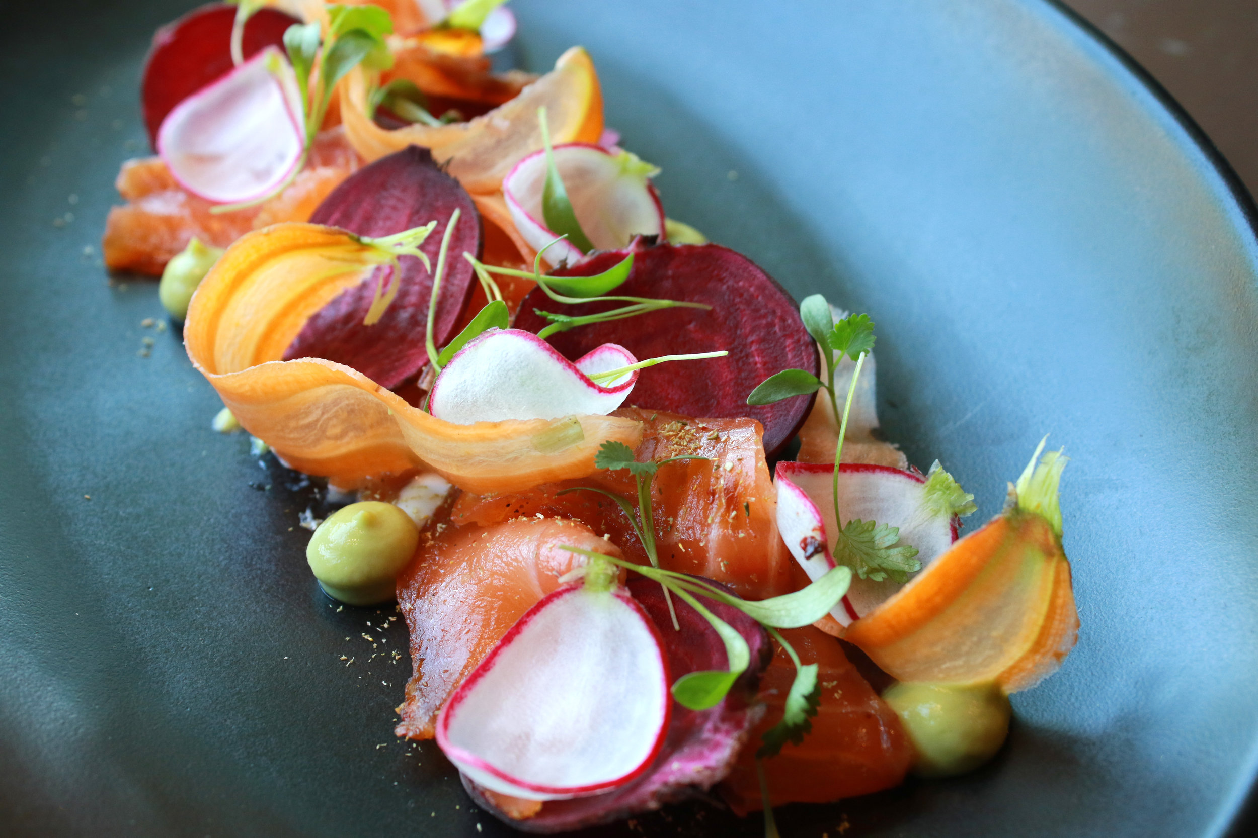 Cured Salmon with morita chile, carrot, radish, beet, and avocado purée.