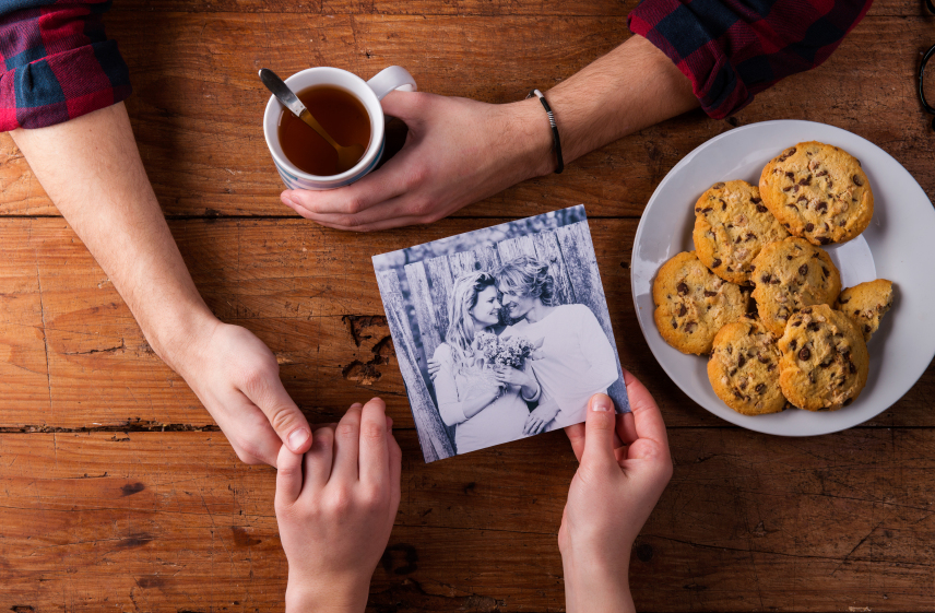 stock-photo-85858605-mans-and-womans-hands-black-and-white-photo-couple-tea-and-co.jpg