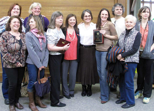 The group accepting the Mayor's Art Organization Award in 2013