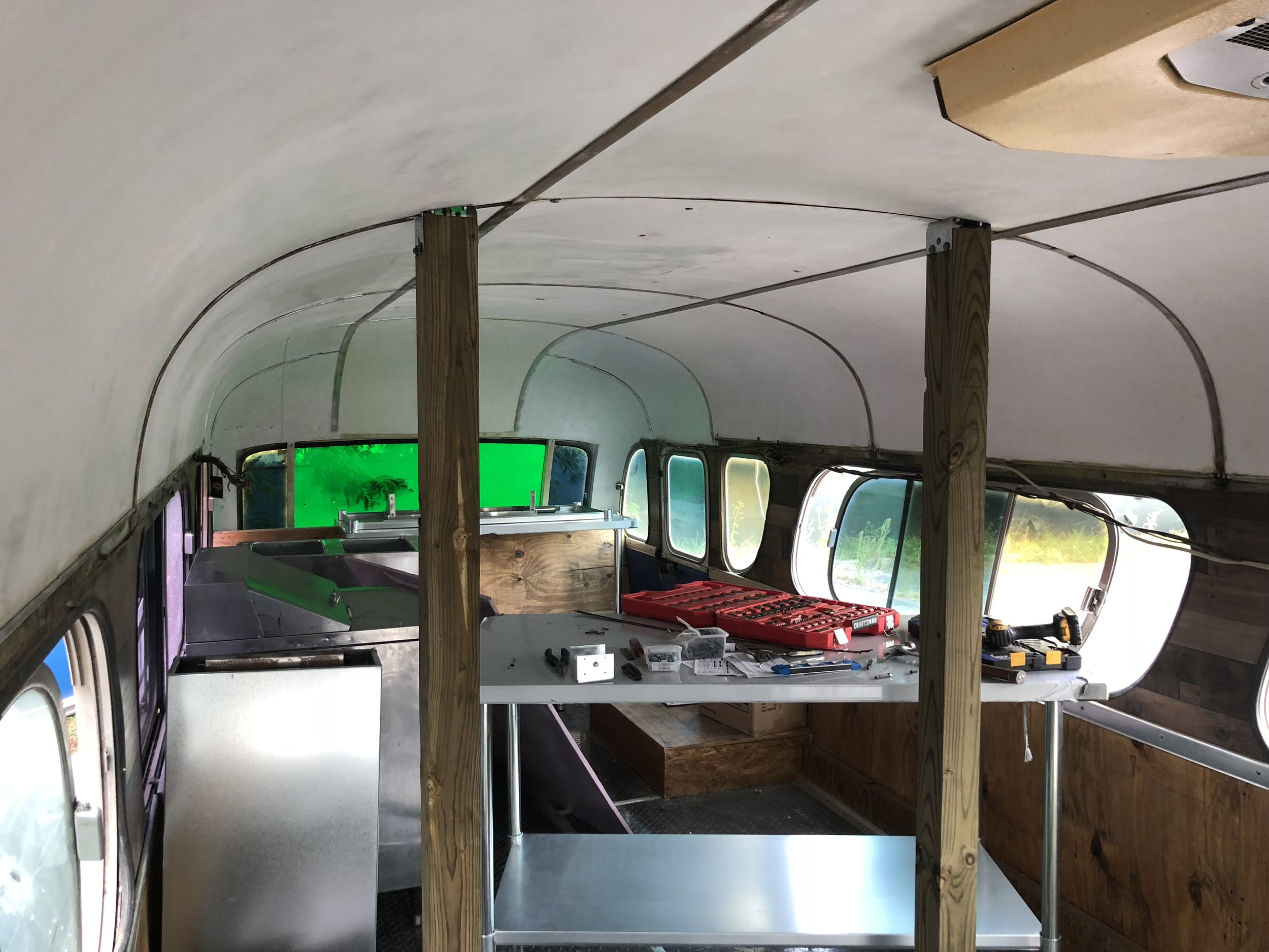 support posts in the center of the bus for the griddle and hood system
