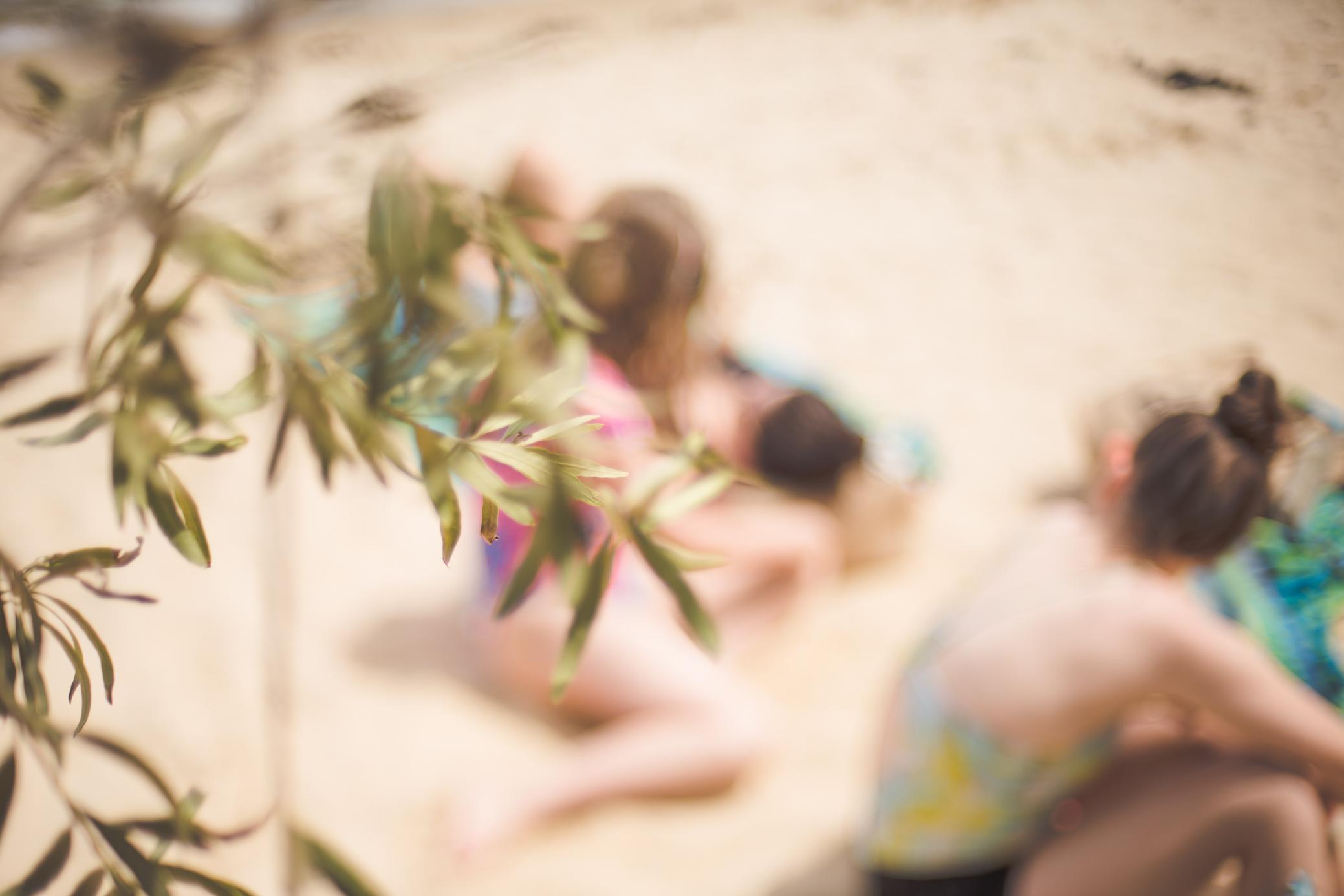 Sydney Photography by Cindy Cavanagh. Three girls sit at Milk Beach in Sydney