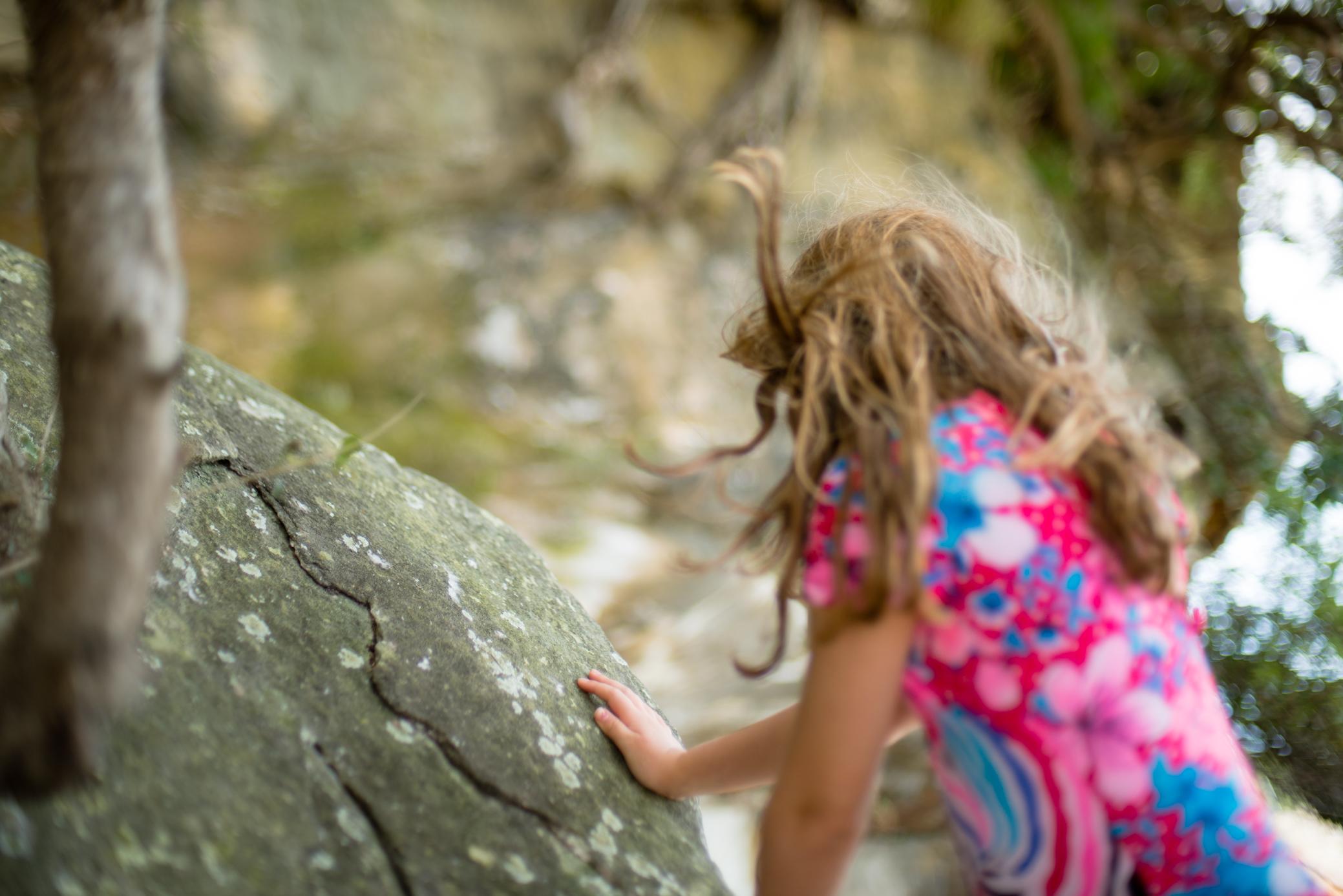 Sydney Lifestyle Photographer, Cindy Cavanagh, captures a girl climbing the rocks at Milk Beach in Sydney