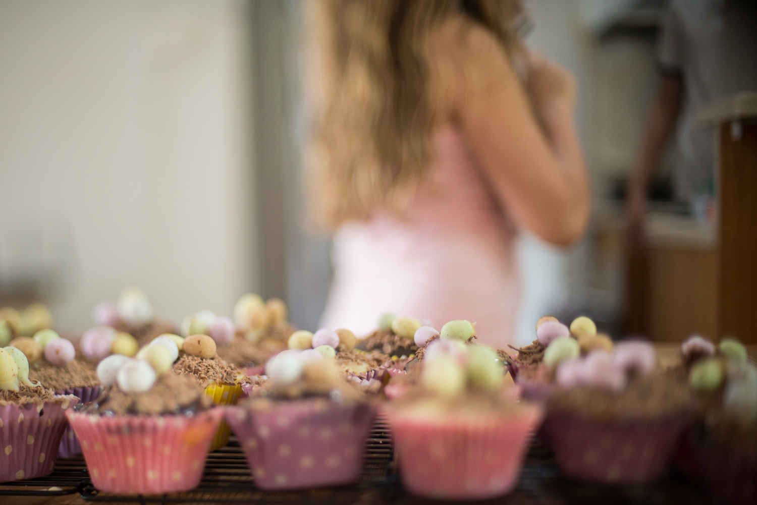 A girl makes vanilla cupcakes in her Sydney home during a lifestyle portrait session with Cindy Cavanagh