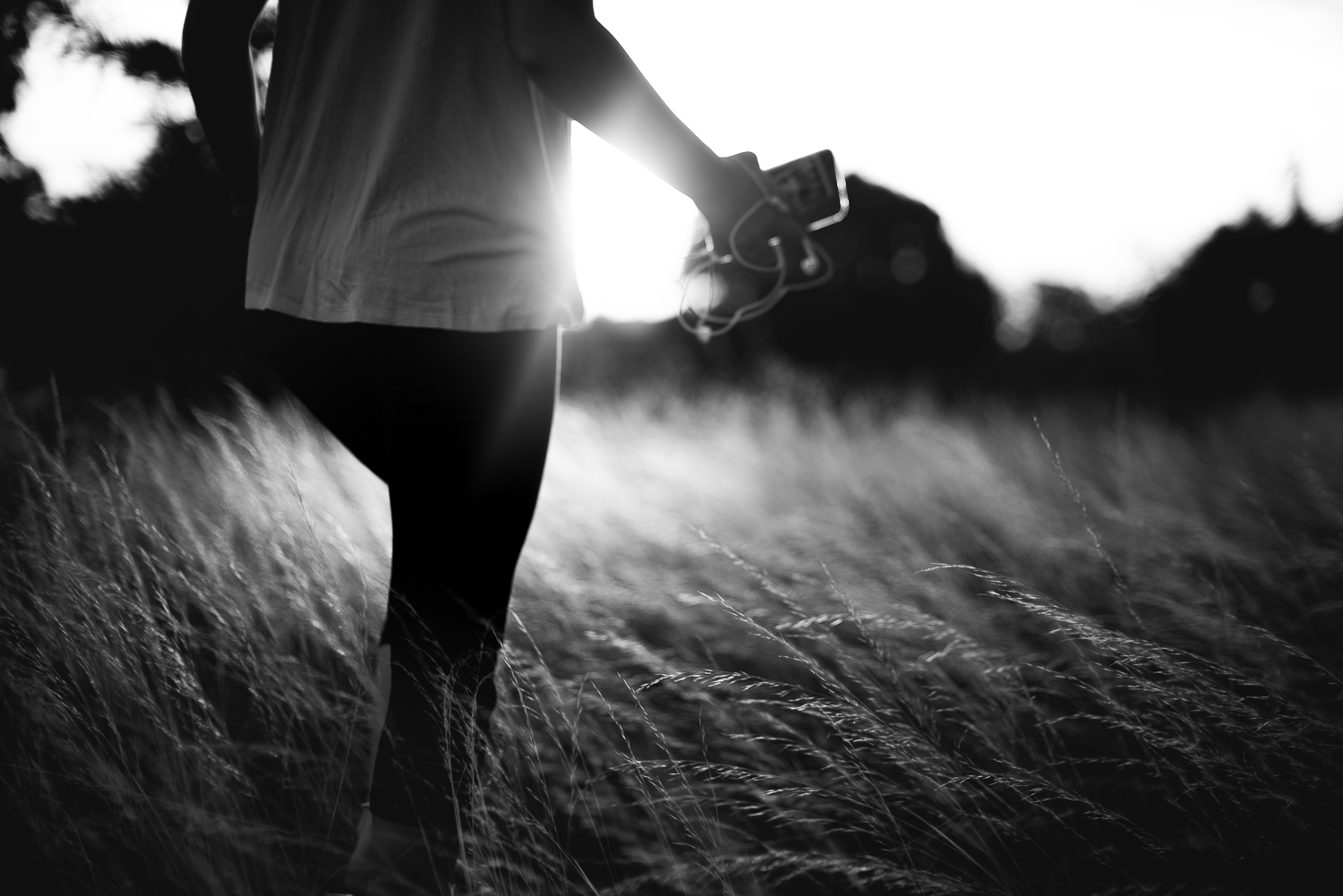 girl walks in a field with afternoon light
