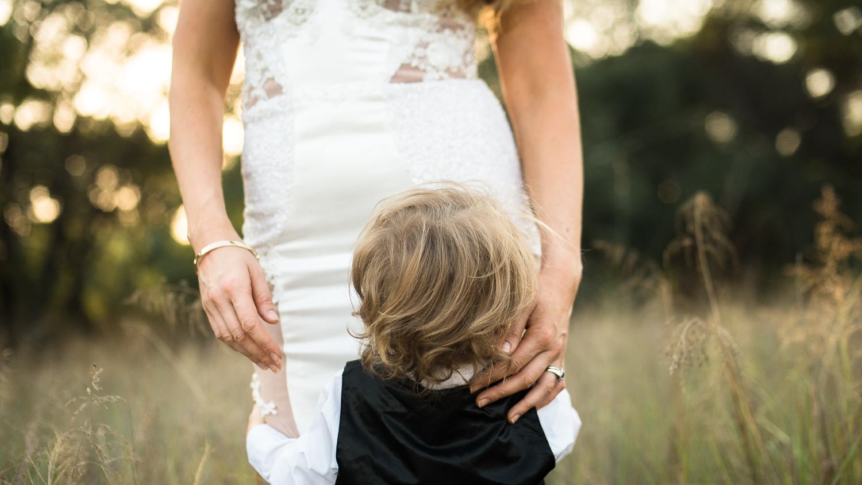 A toddler hugs her mum
