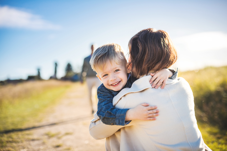 Boy cuddles Mum during a lifestyle portrait session in Sydney.