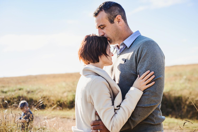 parents hug during a family portrait session