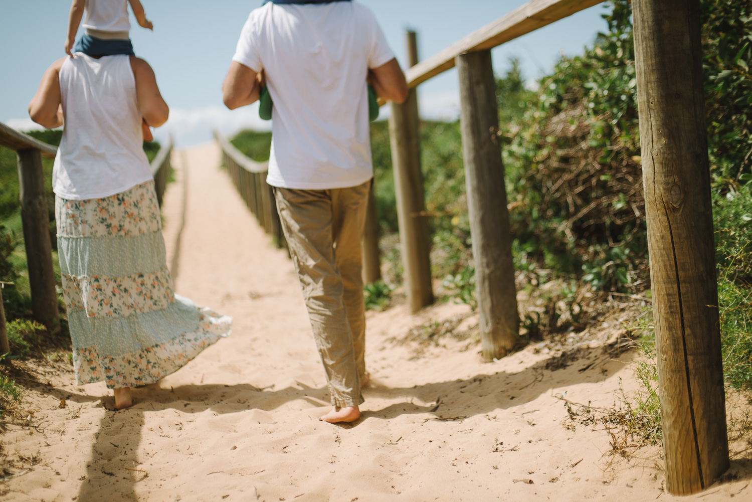 A casual walk to the beach during a beach portrait session in the Northern Beaches of Sydney.