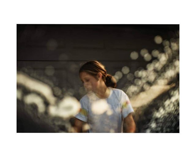"""washing the car, buckets of water, soapsuds,  pretty light, and dancing shadows. Sunday afternoon looks wonderful from the passenger seat.  Our #freelenseddownunder loop. We're a group of Australian and New Zealand based artists dedicated to showcasing images that challenge the conception of """"perfect"""" through the art of freelensing.  Next up is the amazingly talented @camillafrenchphoto  #cindycavanagh #sydneyphotographer #freelensed"""
