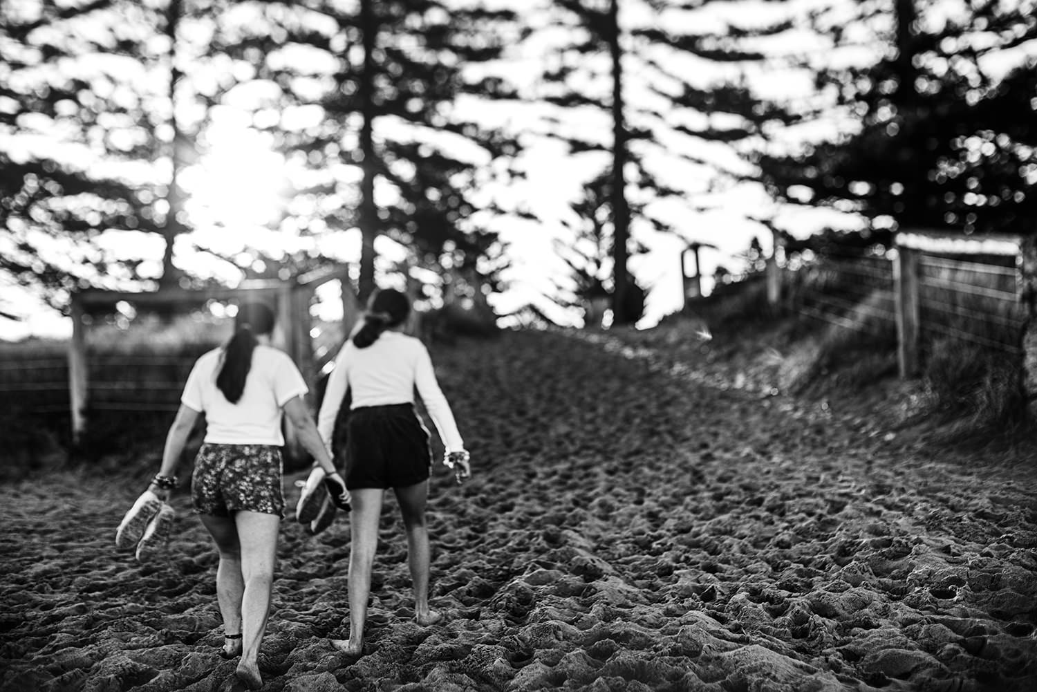 sisters walking as the sunsets at the beach