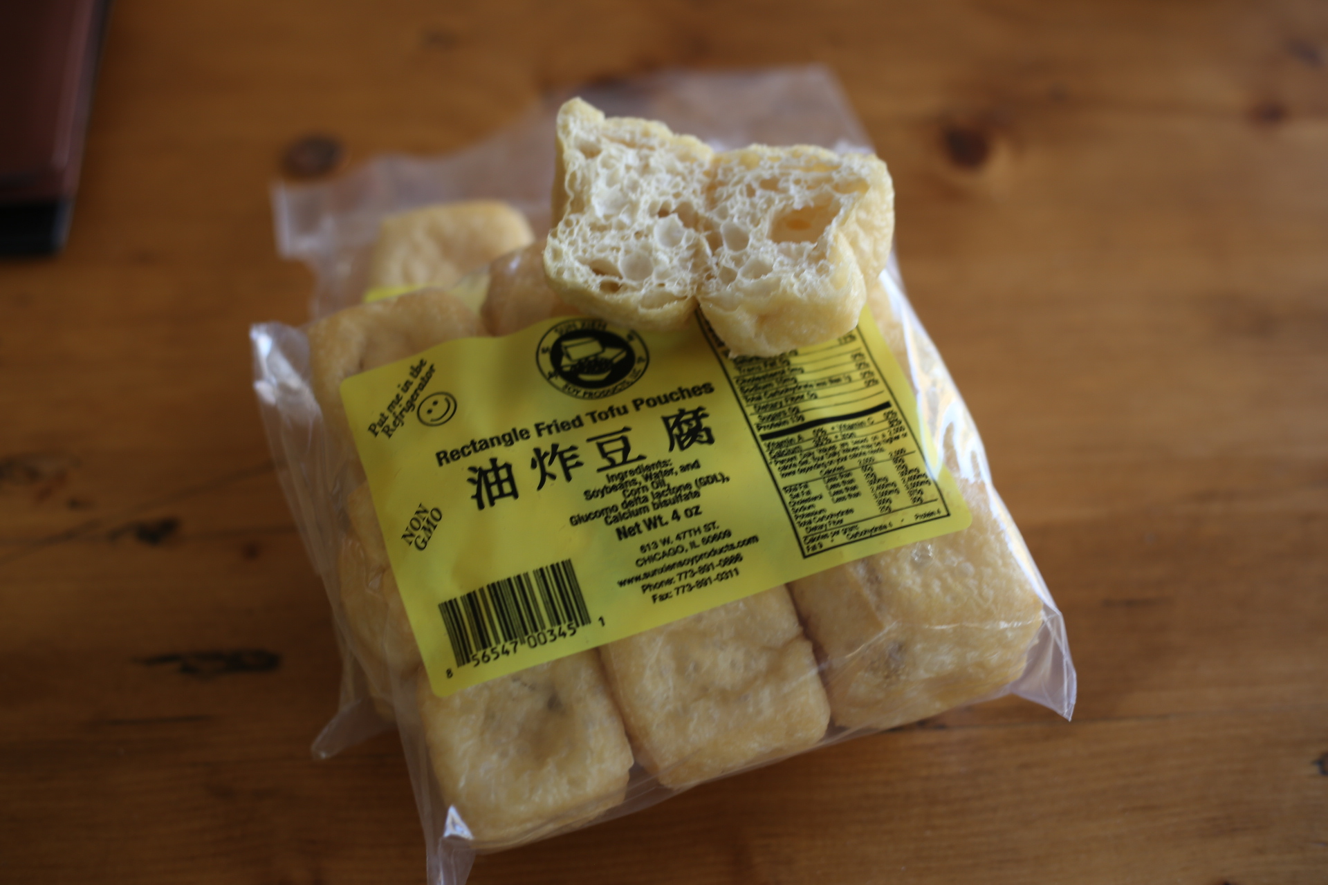 Add fried tofu pouches which soaks up the delicious broth (available at Tai Nam Market). Add cooked rice noodles as well.