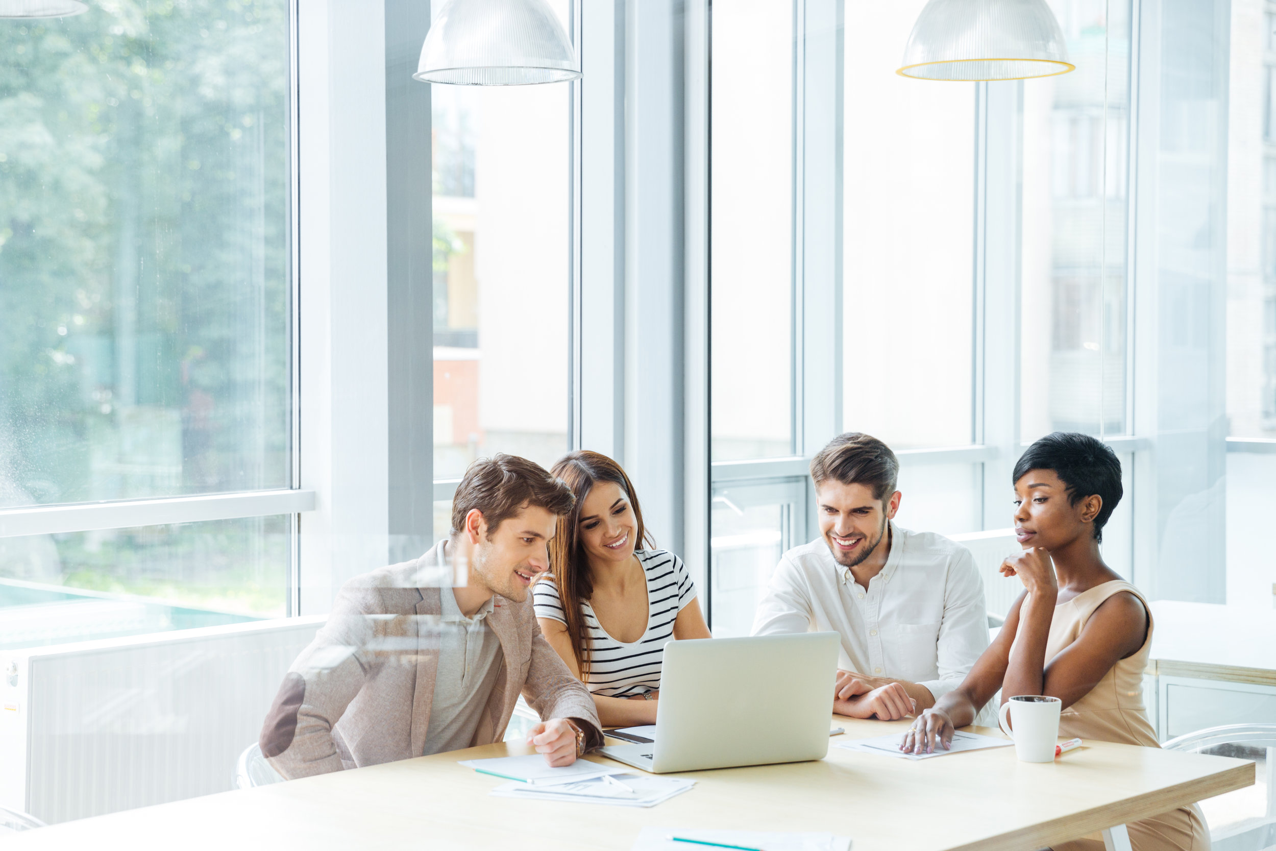 happy-business-team-working-with-laptop-together-P7N6VU9.jpg