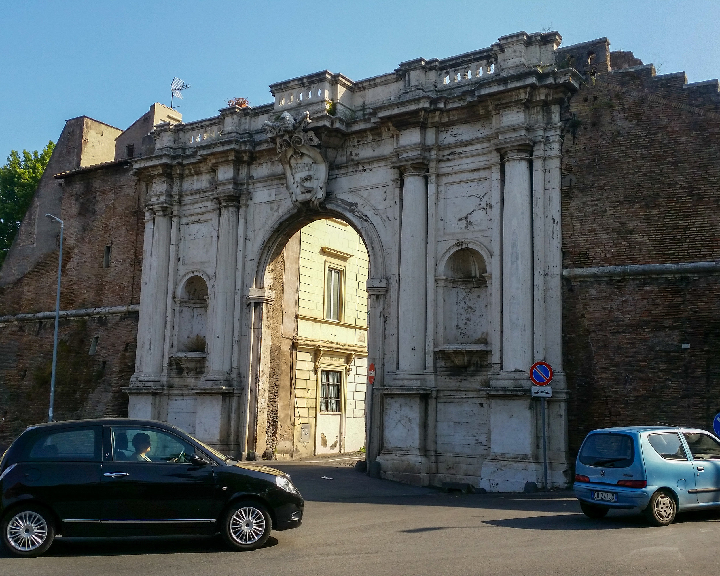 A rather handsome arch spied on a morning jog through Rome, Italy. Gee that was a tough, hot run but worth it!