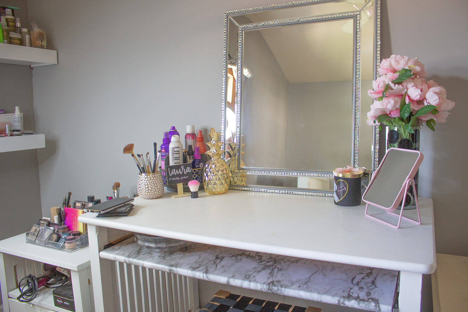 This somewhat DIY makeup vanity is an old desk that I painted white. The pull out shelf is lined with marble contact paper.