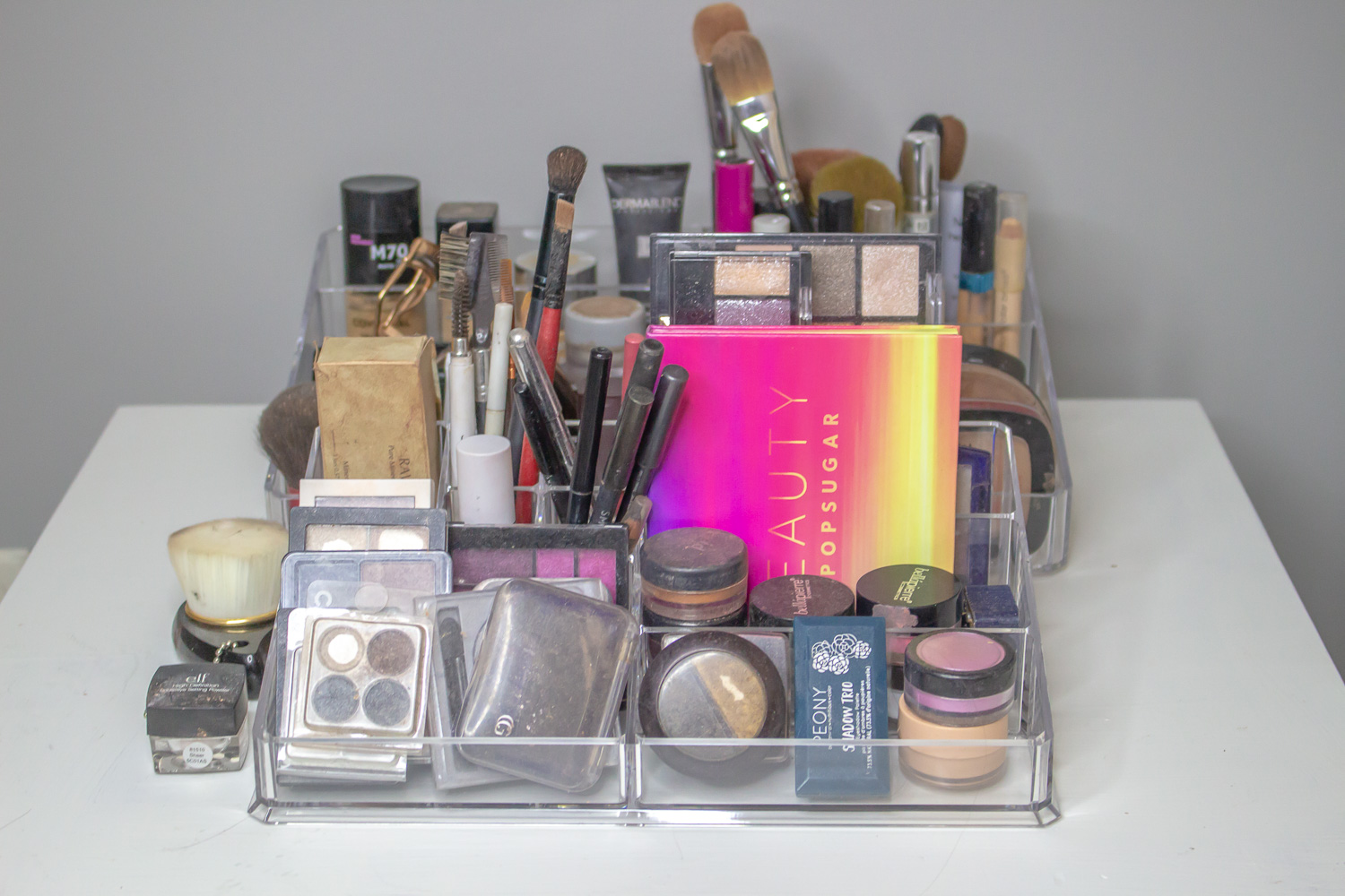 After: I used acrylic trays to help organize my makeup.