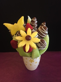 Just A Touch Of Spring  One of our smaller bouquets, perfect for any occasion. Honey dew wedges, strawberries and apples with milk chocolate and white swirls.  $35   Send Request