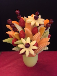 Simply Fruit Bouquet  Delicious blend of cantaloupe, honeydew, strawberries, grapes, oranges and pineapple daisies  $50/$60/$70   Send Request