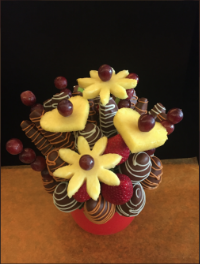 Tiger Bouquet  Strawberries and apples with milk chocolate swirled in white chocolate and butterscotch. Grapes, pineapple hearts and daisies complete this bouquet  $50/$60/$70   Send Request