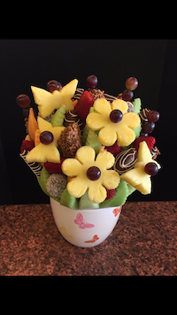 Celebration  This party celebration bouquet is packed full of honey dew, cantaloupe, strawberries, pineapple, apples and grapes. Apples and strawberries are covered in milk, skor and coconut  $100 (15-20 people)  $115 (20-25 people)