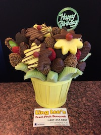 Chocolate Indulgence  Every chocolate lovers dream. This bouquet has a honey dew melon trim, filled with apples, strawberries and pineapple. Dipped with milk oreo and skor  $65/$75/$85
