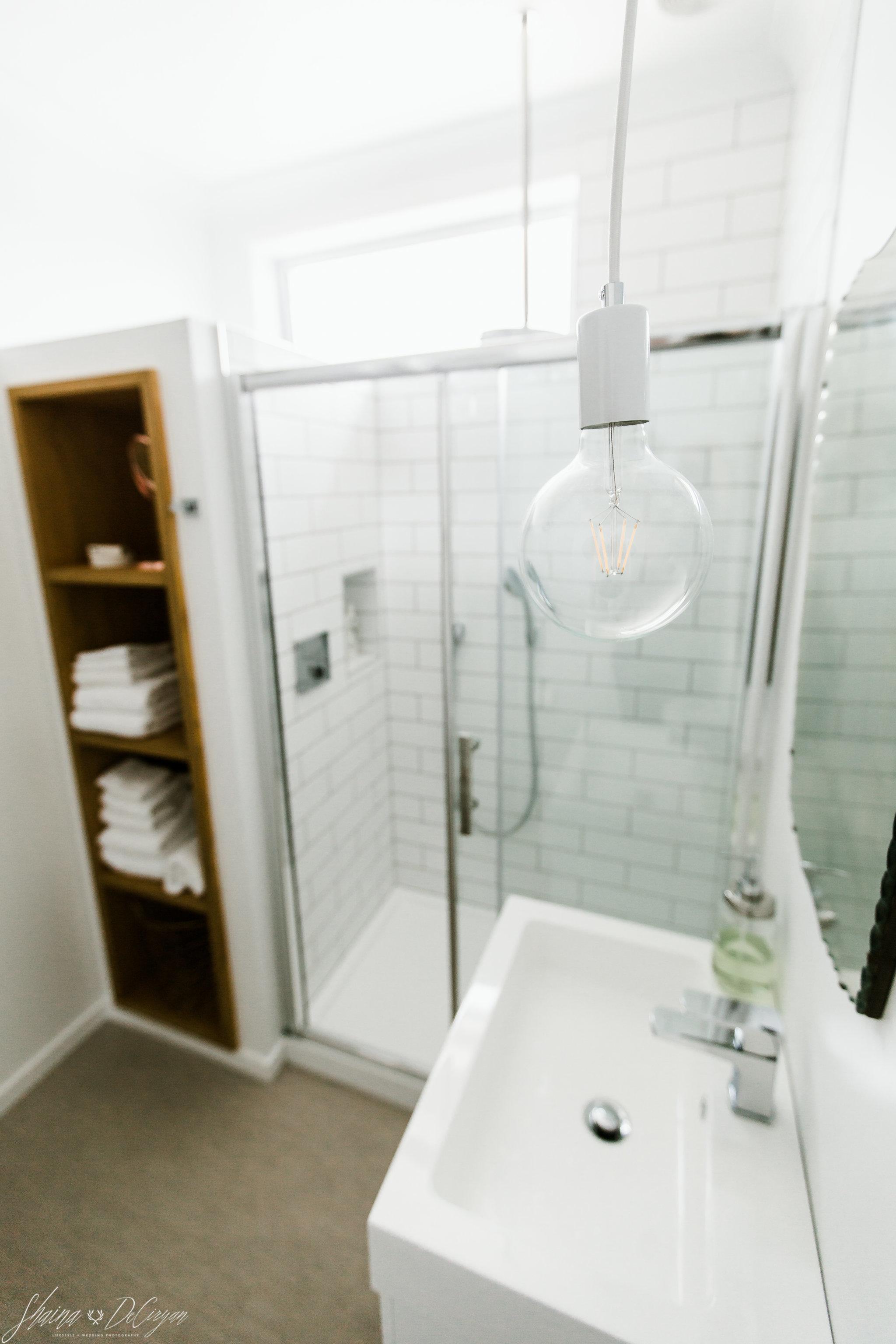 BathroomwithCopperDetailsWhiteSubwayTile-HeadmastersHouseatPortMolyneuxSchool7.jpg