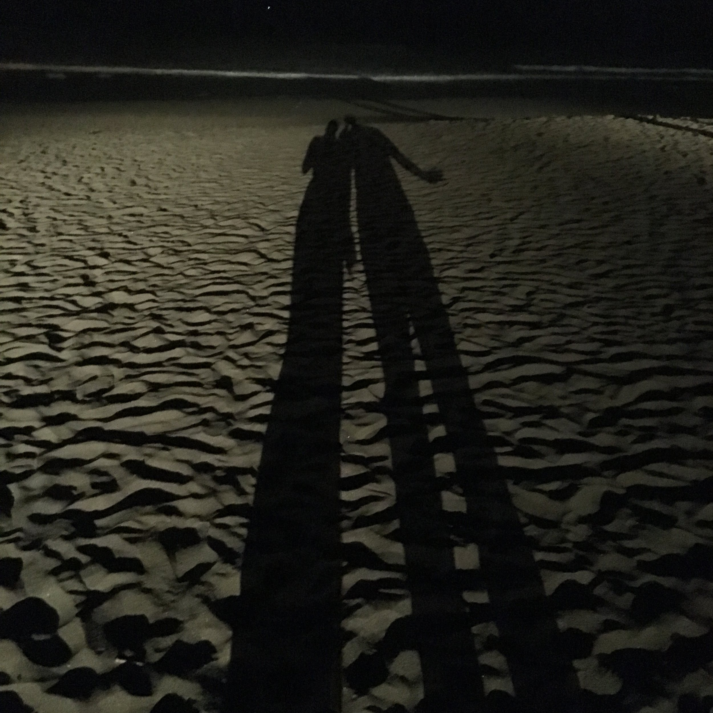 Our shadows on the beach at Seminyak...