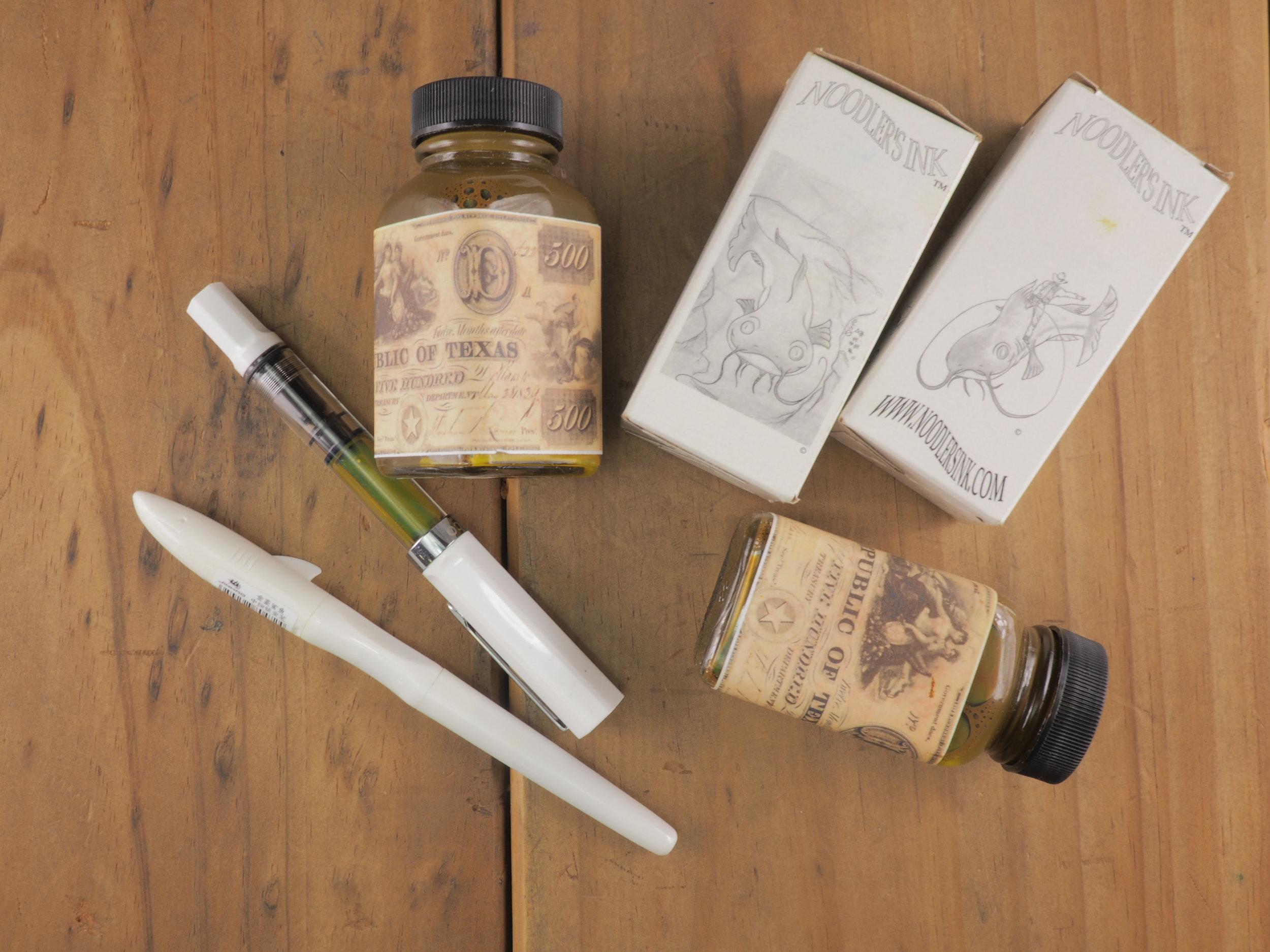 Bottles and Pens.JPG