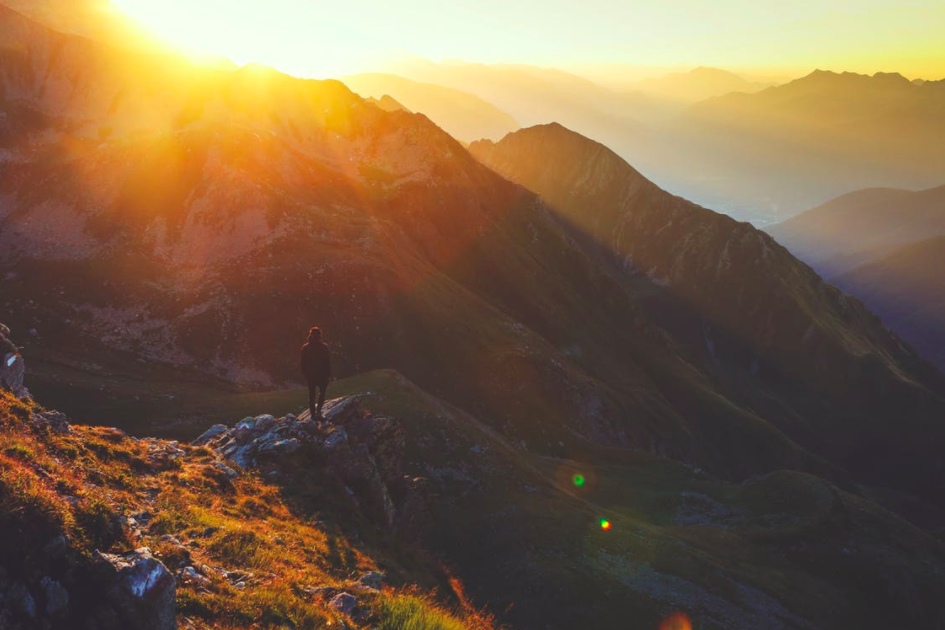 Source: https://www.pexels.com/photo/mountains-sun-sunrise-morning-100077/