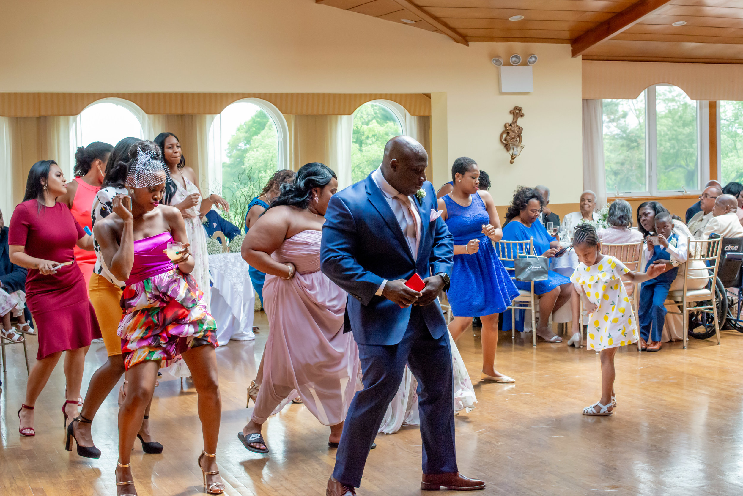 Douglaston Manor Wedding Guests dancing at reception