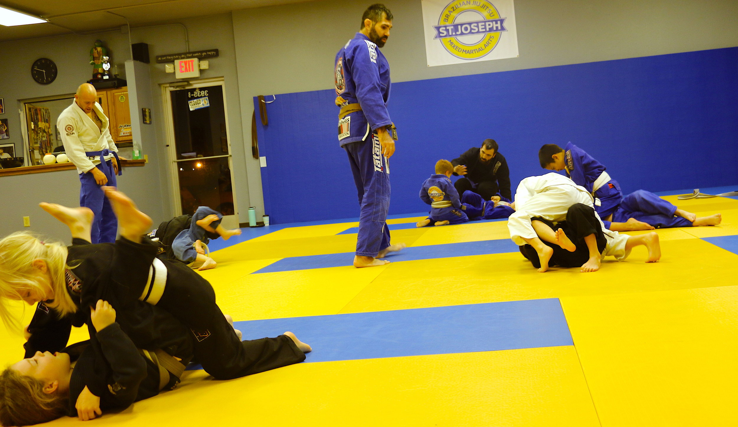 Our 5-8 year olds practicing mount escapes, a vital movement in Jiu Jitsu and a potential position that may occur during a run in with a bully.