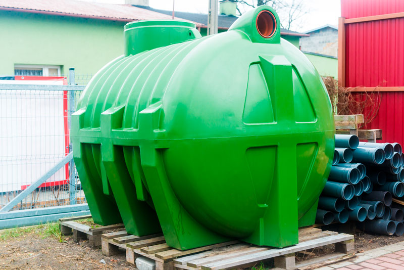 Huge green septic tank
