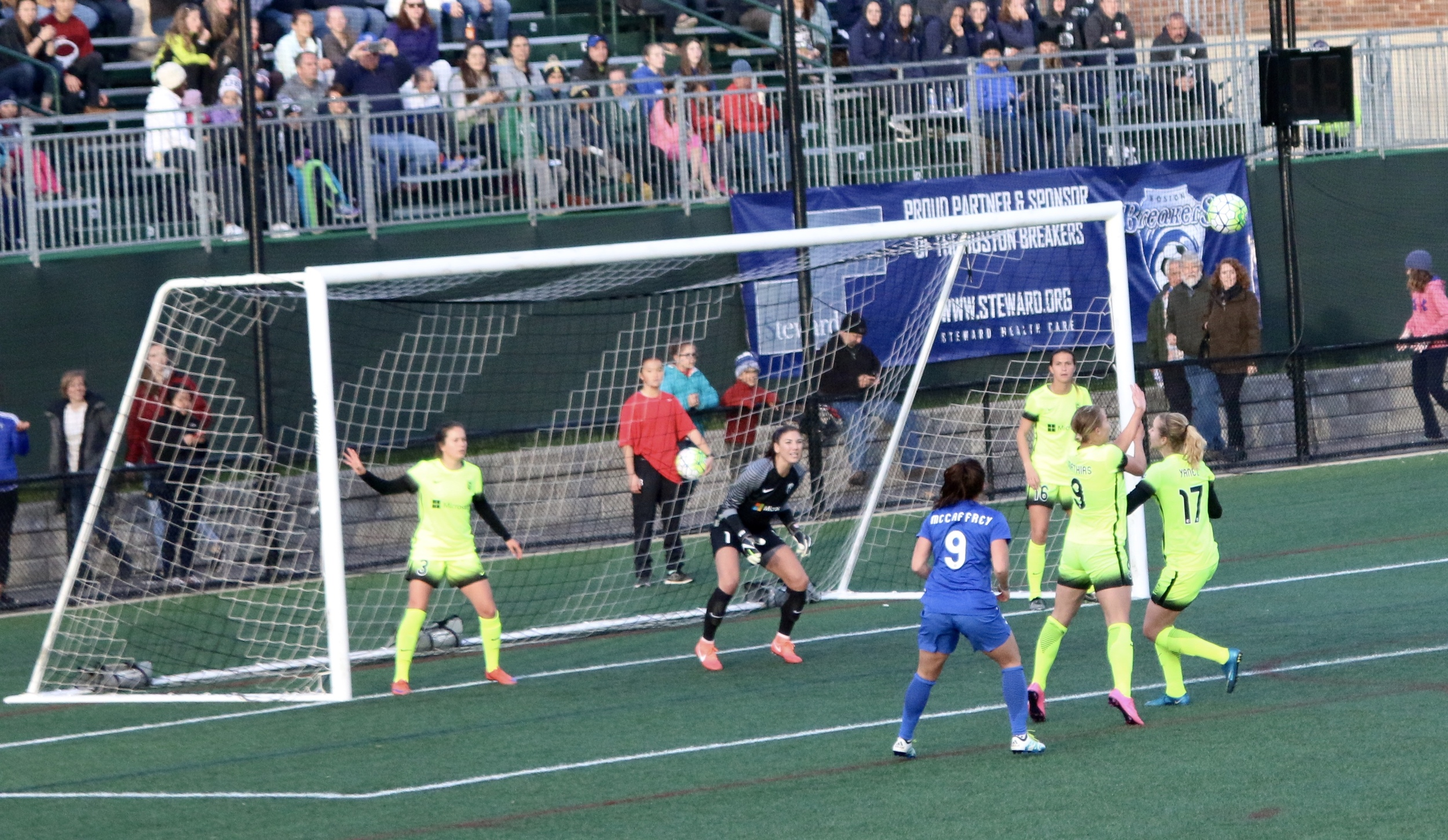 I wanted to photoshop out the ball girl in red and the ball in the air so that it looked like there was a ball in the net behind hope solo.