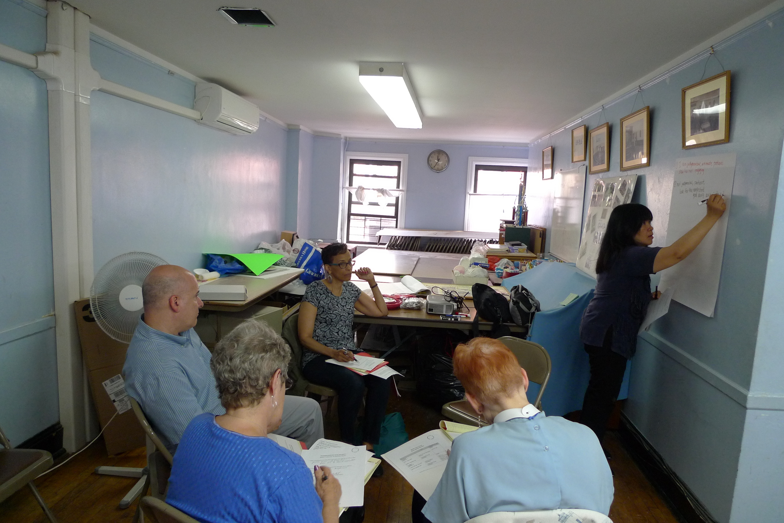 May Lee facilitating Theological Reflection Group discussion.