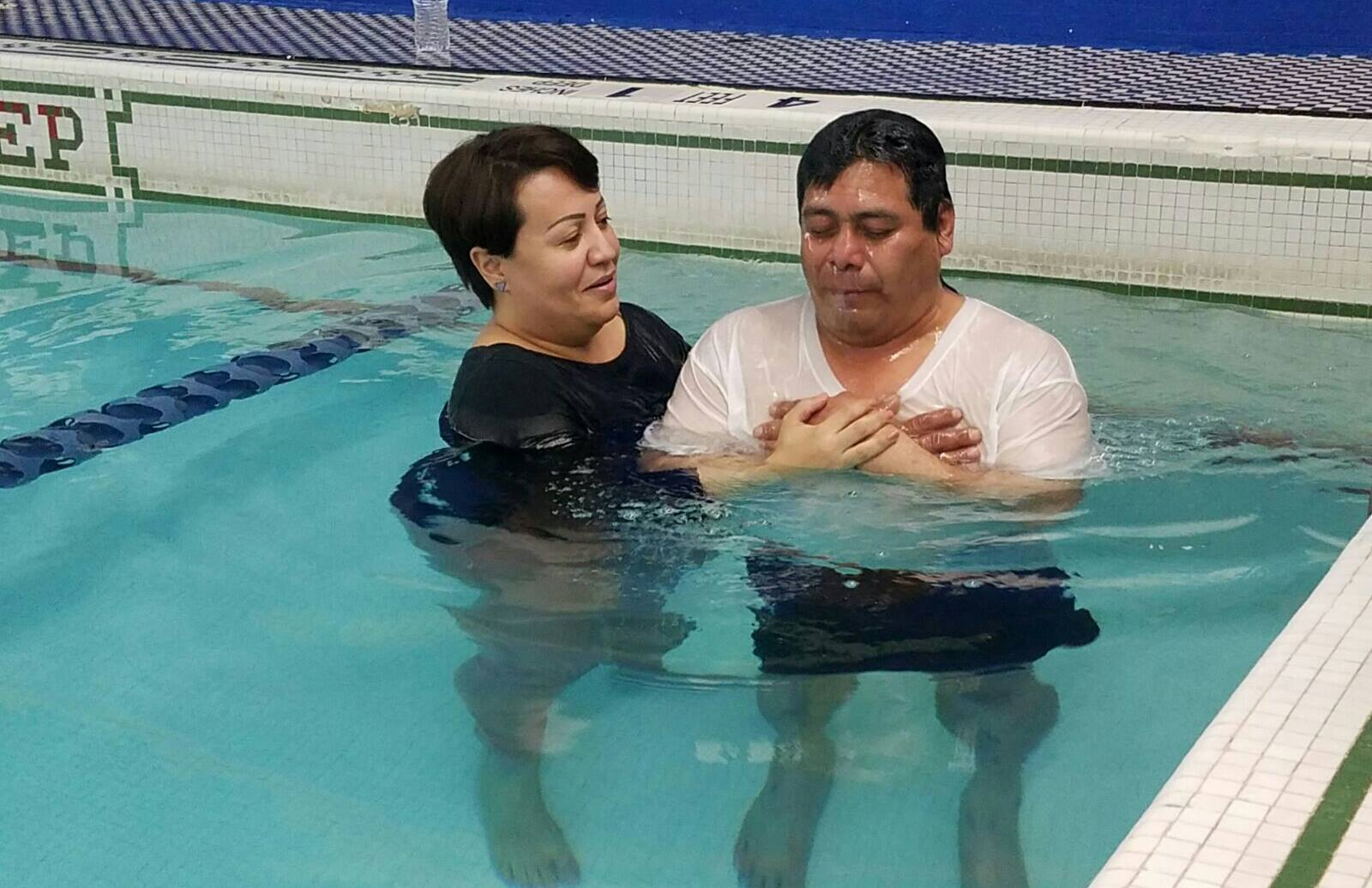 Lourdes baptizing a brother, who surrendered his life to Jesus, since the homeless outreach work began.