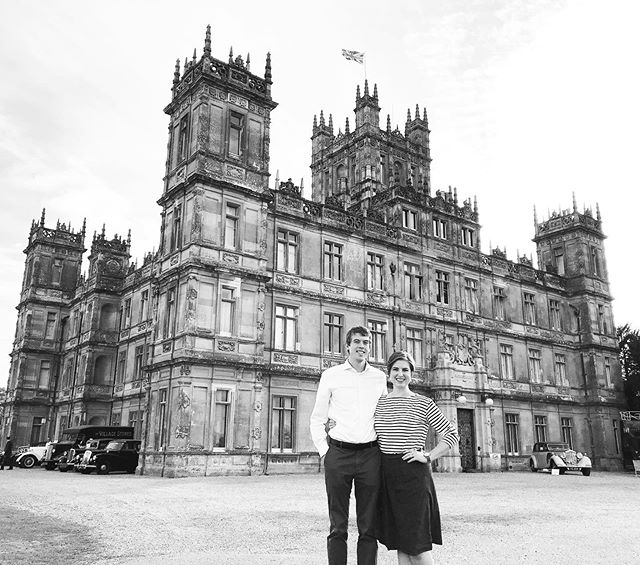 """Just over a year ago, Hans and I visited Highclere Castle in England (""""the real Downton Abbey""""), and the day was one of my absolute favorites from our entire time abroad. We were there for their """"Heroes at Highclere"""" event celebrating 100 years since the end of WWI. We listened to speakers and a glorious Scottish pipe band, wandered around the estate, watched a mock dogfight with authentic period airplanes, and toured the castle right at the end of the day.  You guys, I cried about fourteen times.  You see, my mom and I discovered Downton Abbey during the first season, before nearly anyone else in the States, and it became that was just """"for us."""" Neither my dad nor my little sister were interested, although a couple years later I introduced the show to Hans and he binged the first three episodes on a school night.  In those odd years of the mother-daughter relationship, where we were trying to figure out how to relate to each other as adults, Downton Abbey was this beautiful common ground. We would madly text back and forth each week, dissecting the most recent episode and swapping predictions and swooning over the costumes.  She died less than a year after the last episode aired.  And when Hans and I visited Highclere, as beautiful and fun as that day was, it was bittersweet because I couldn't share it with her.  Seeing the movie (which they started filming the day after we were there) without her was also bittersweet. As the camera panned up the gravel drive towards Highclere and the music swelled, I definitely got misty eyed. Because even though where she is now is far more glorious than any old English estate, I still wish she could have been next to me in that moment.  All that to say...Downton, it was so good to be back.  #DowntonAbbey #HighclereCastle @downtonabbey_official @highclere_castle"""