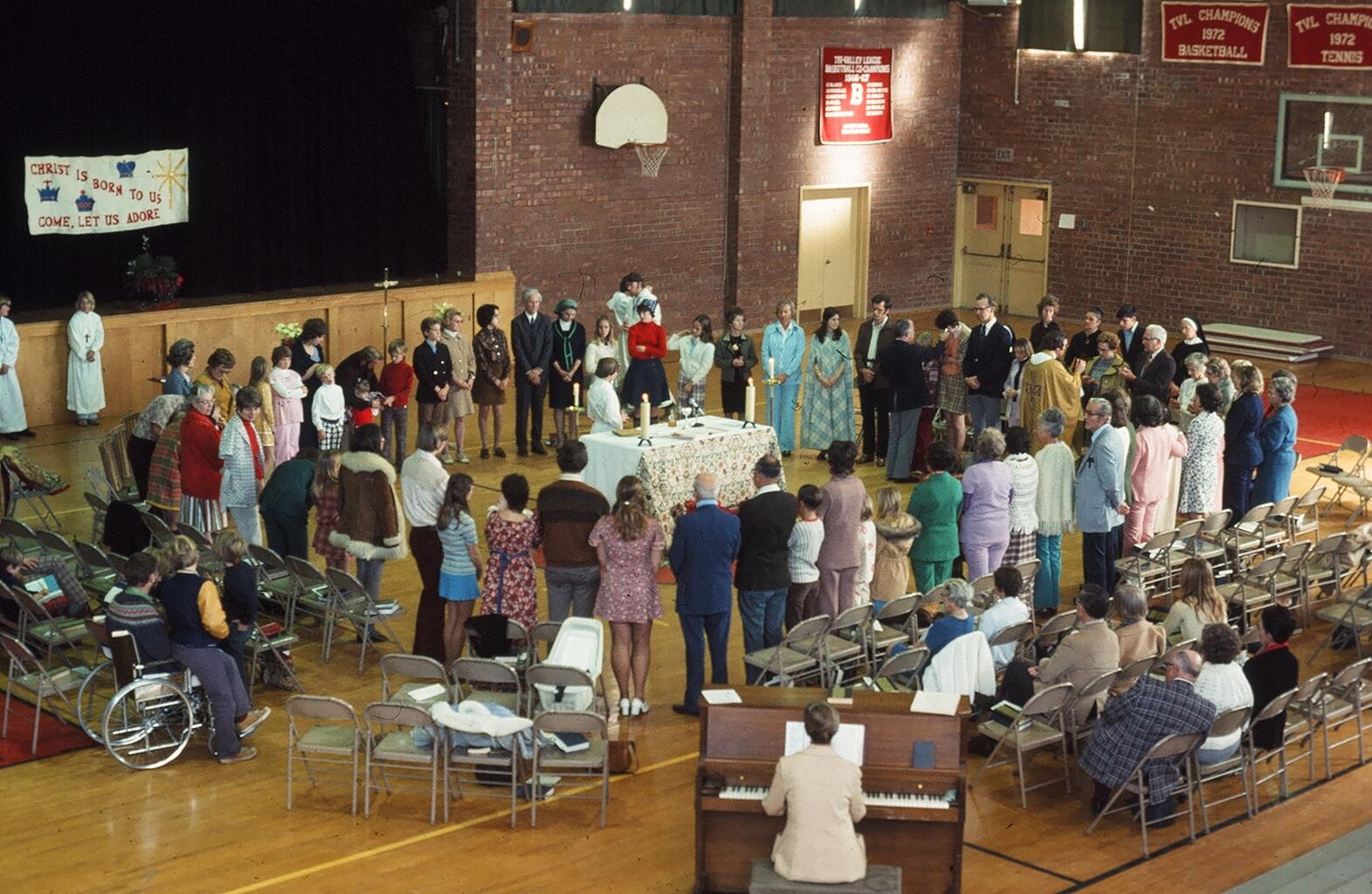 Worshiping in the high school gymnasium ca. 1973