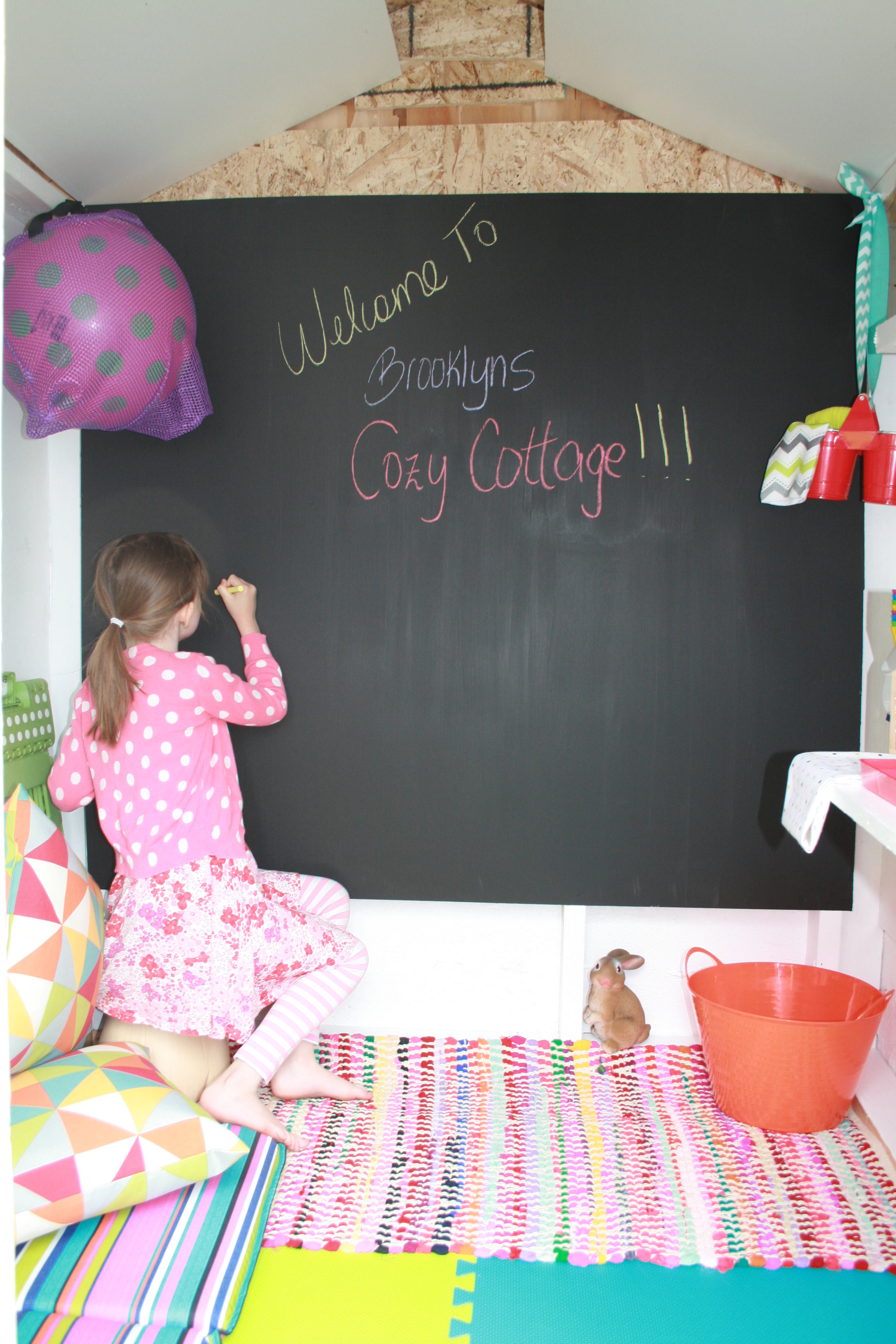 We used chalkboard paint to fill the whole back wall for a place to write, draw and get silly:)