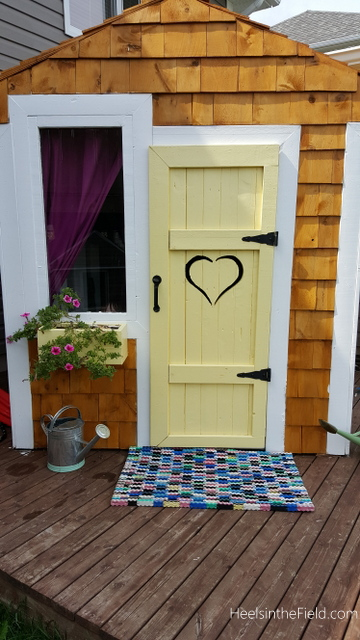 Finished and complete with fun colours, stained cedar shakes, a window box and recycled flip flop welcome mat!
