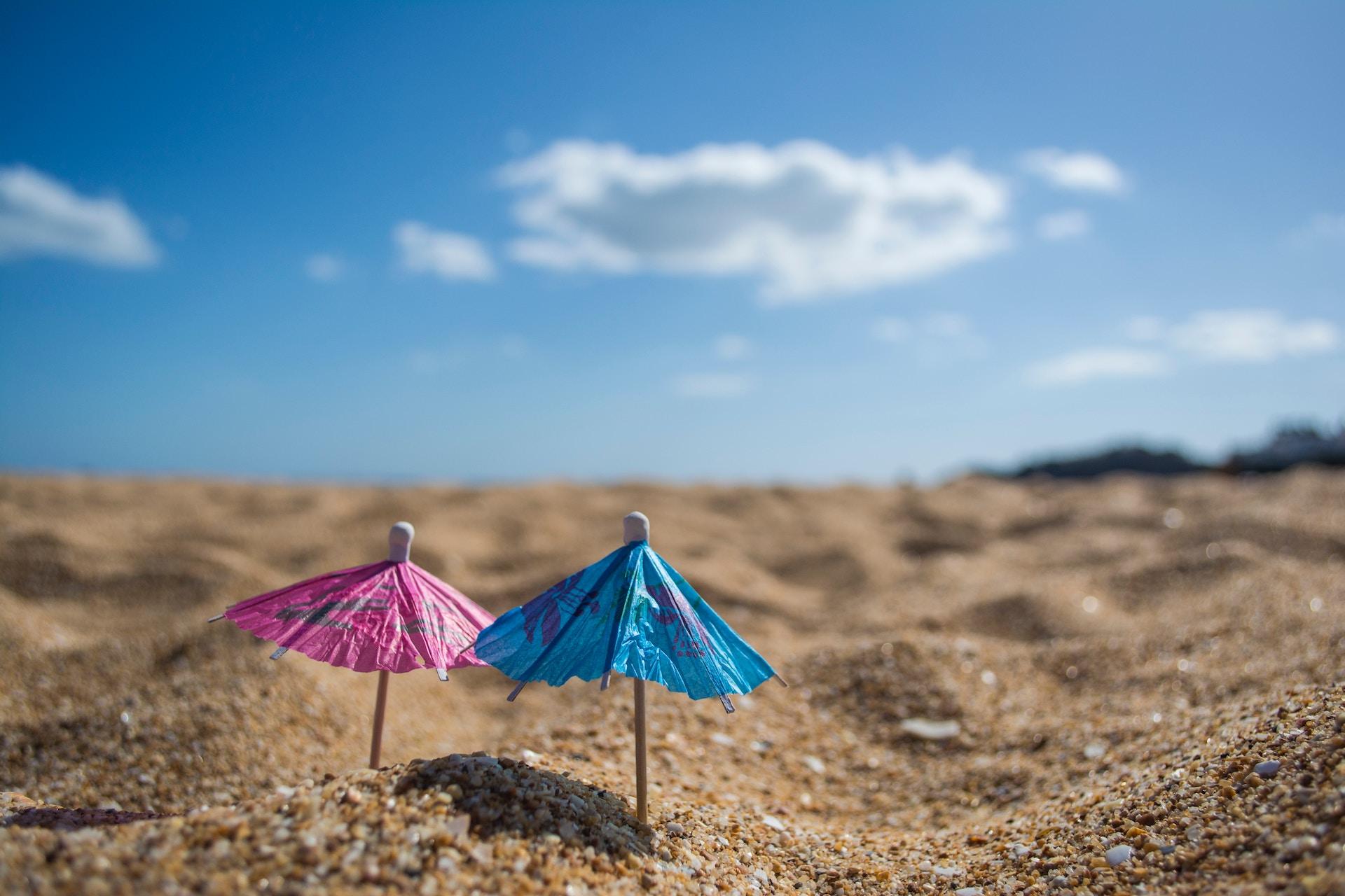 little drink umbrellas in sand.jpg