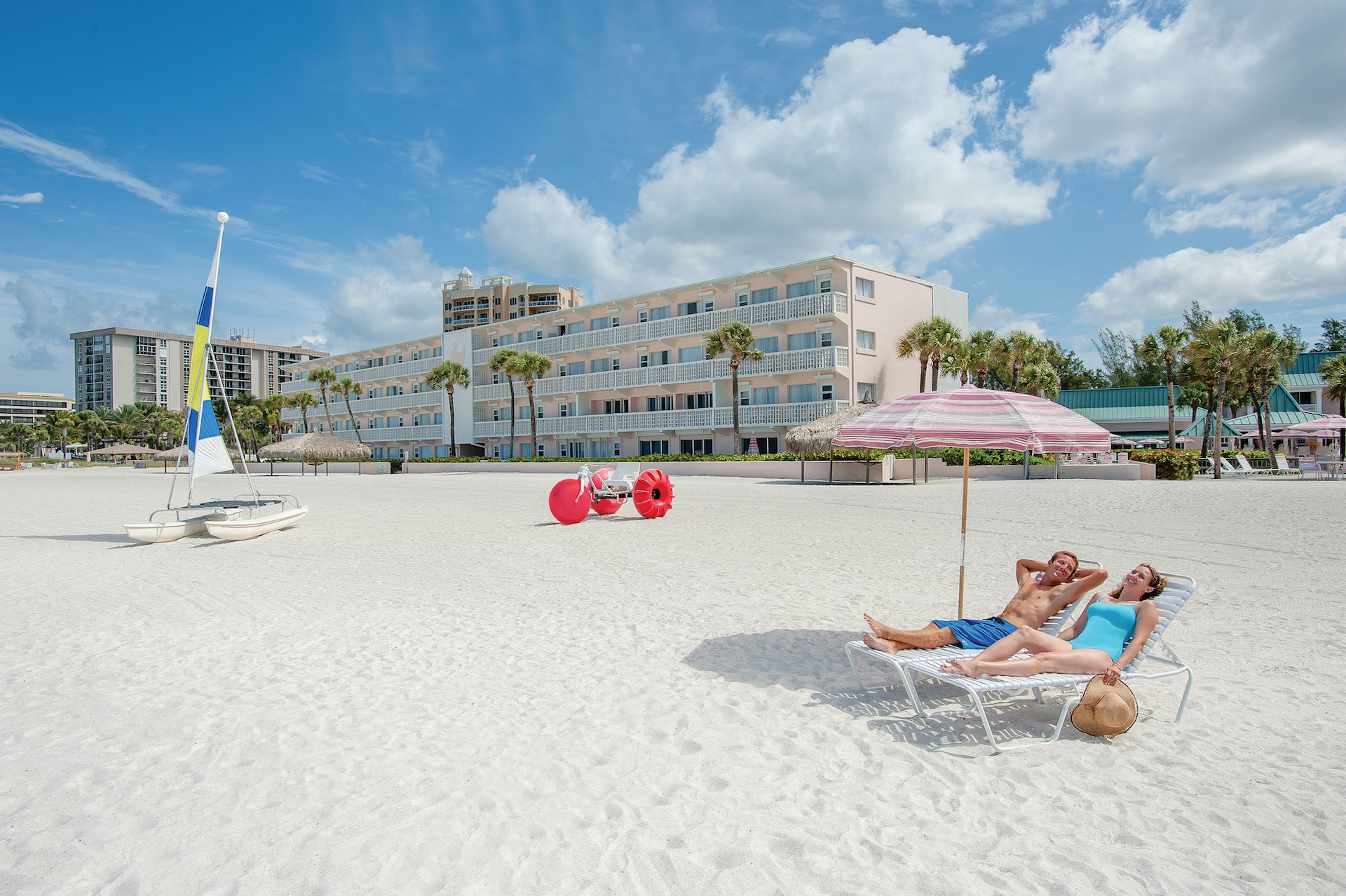 couple lounging on beach chairs at Sandcastle Resort at Lido Beach.jpg