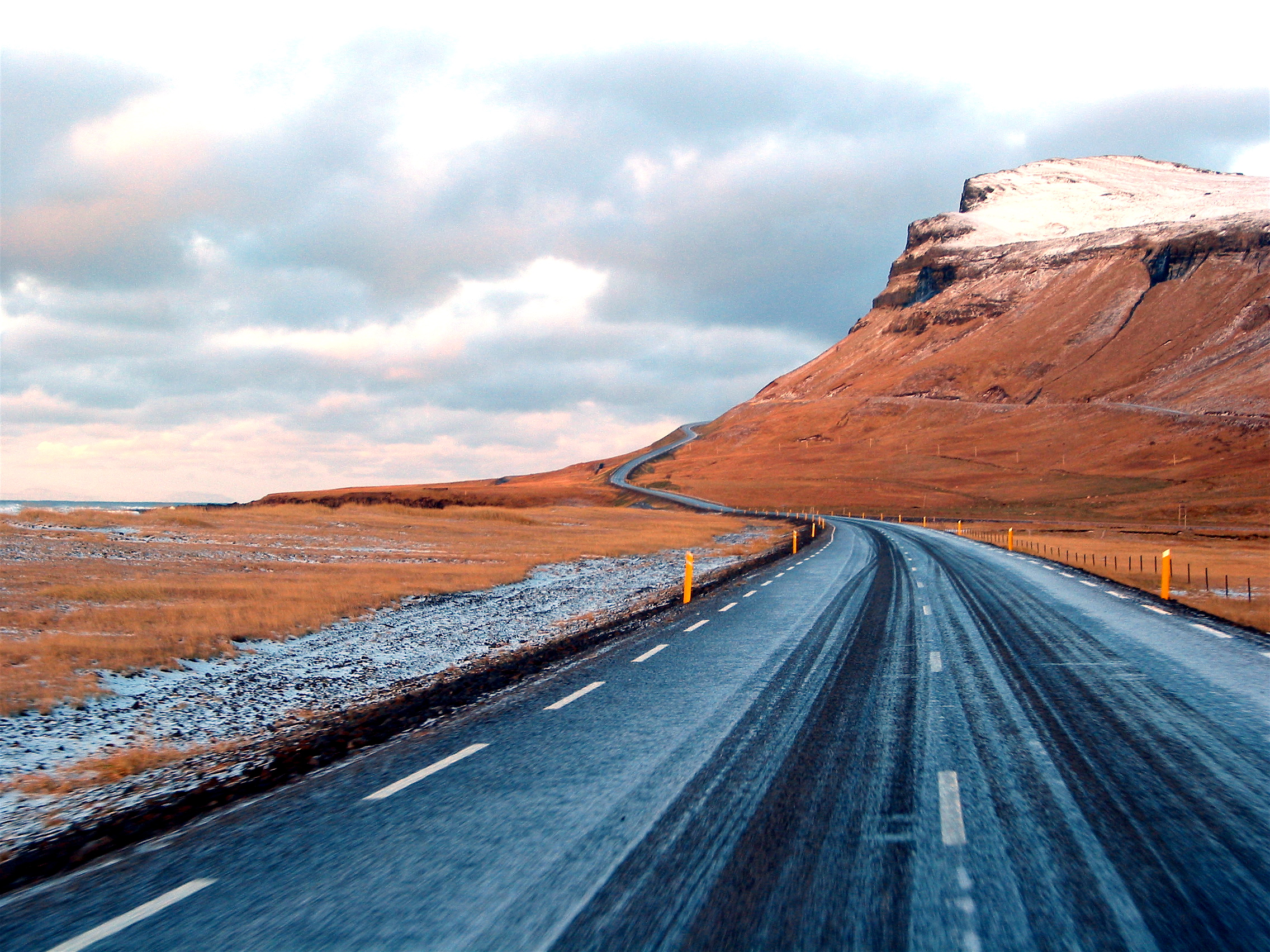 Icelandic Road Freezing, 2007  This image is a good example of using a vanishing point to lead the viewer's eye directly into the center of the composition.  It also has a bit of mystery as one wonders what is over the hill in the distance.