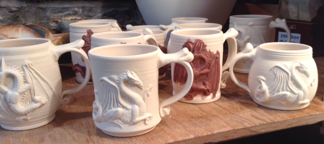 After they are out of the bisque kiln, I paint red iron oxide on the dragons.