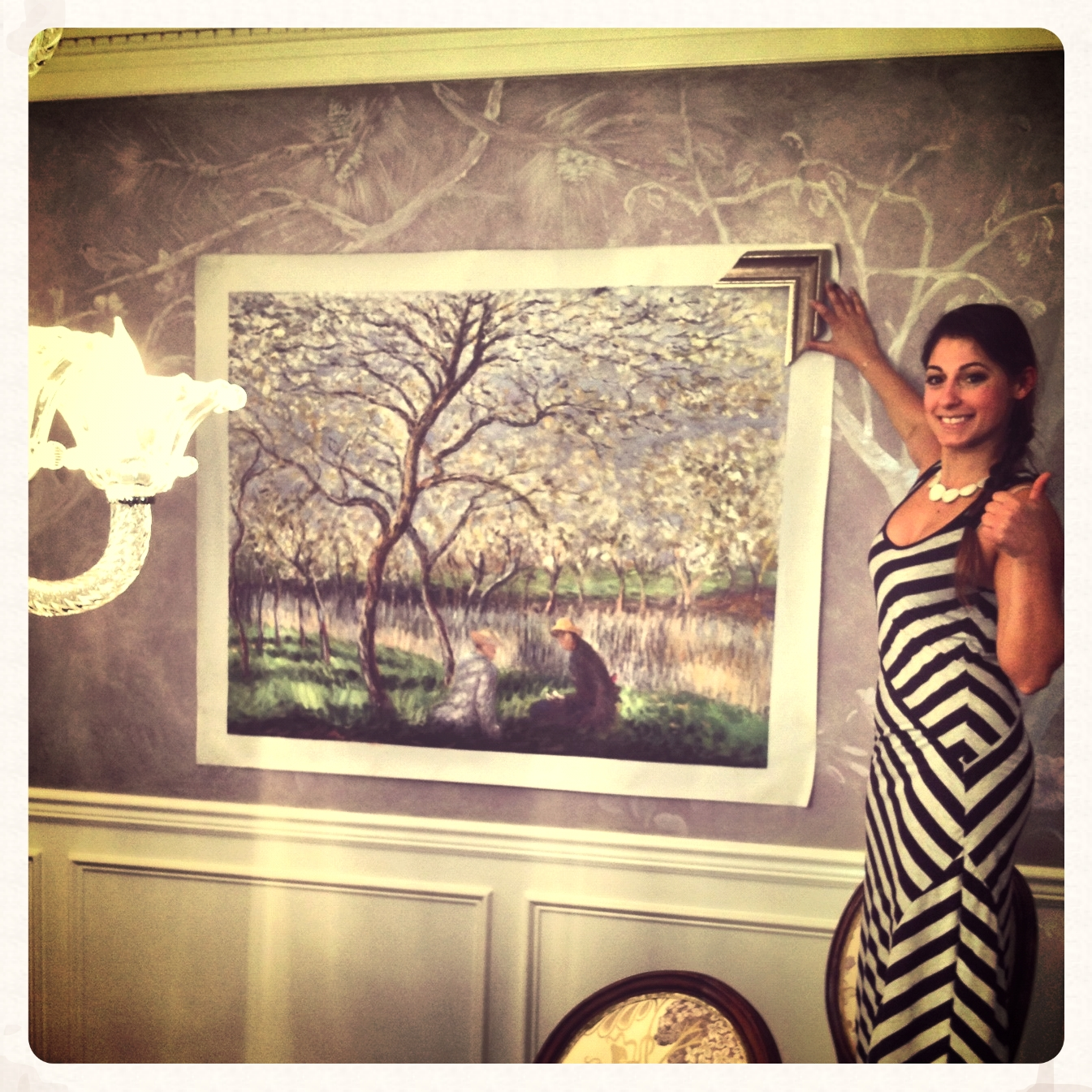 After handpainting a mural that wrapped around this dining room, its time for cusotm art & frame