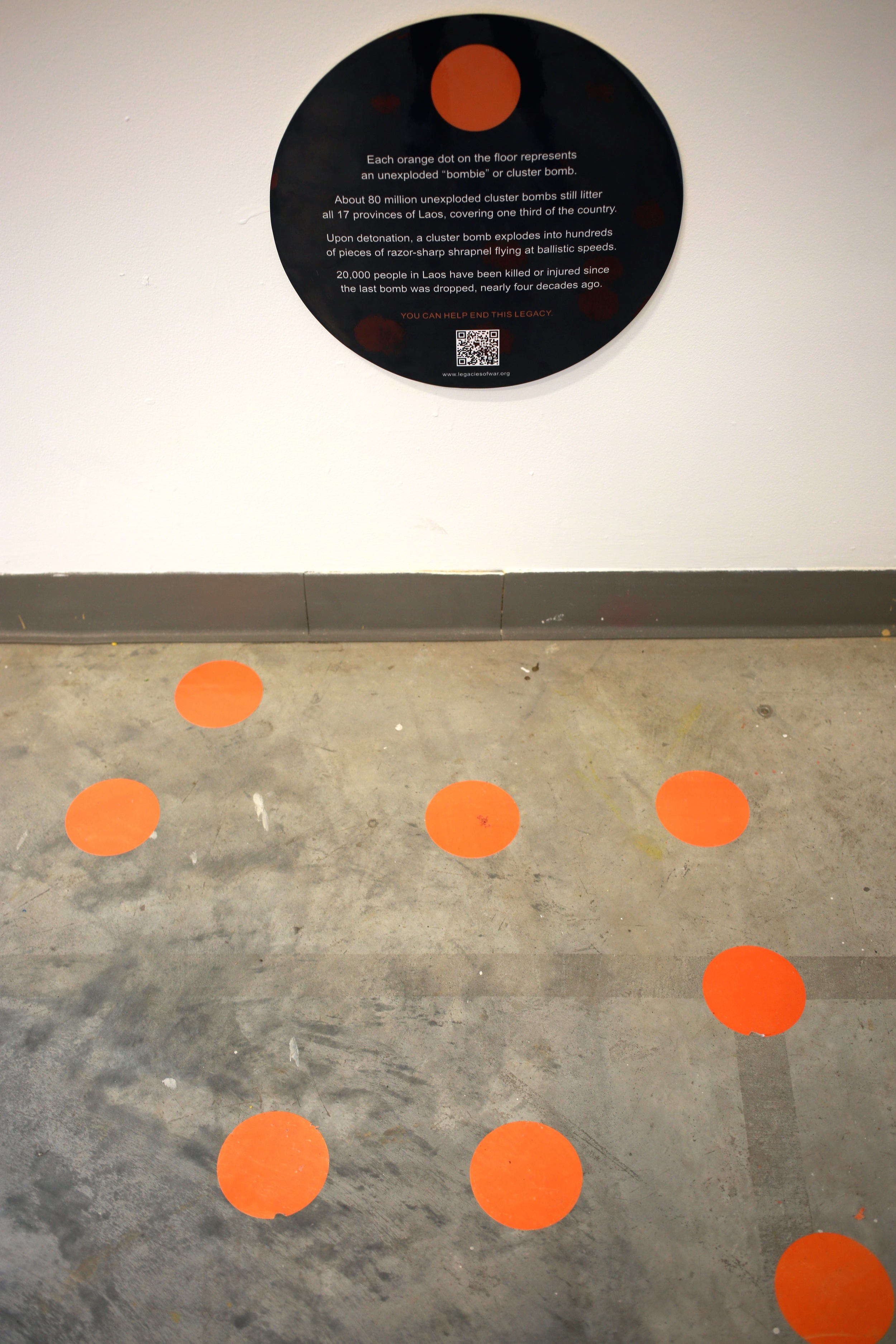 Floor dots representing the unexploded bombs still remaining in Laos, by Legacies of War